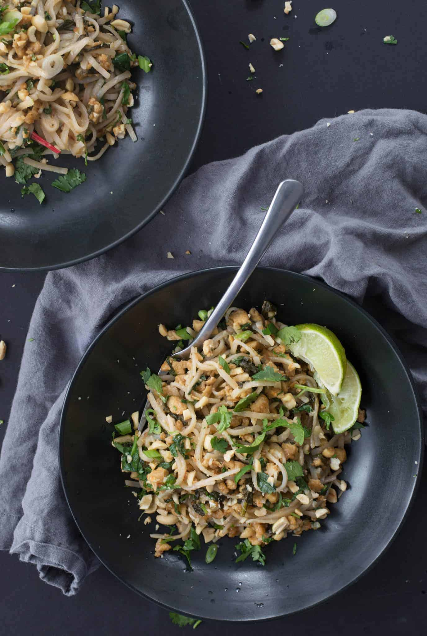 15 minute vegan pad thai! Save this one when you need a quick, healthy meal. Crispy tofu, brown rice noodles, spinach, peanuts and a simple pad thai sauce. | www.delishknowledge.com