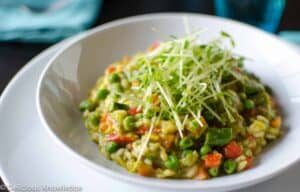 Spring Risotto with Pea Coulis and Pea Shoot Salad. An elegant spring pasta dish that's packed with vegetables and layers of flavor! Vegan and gluten-free.