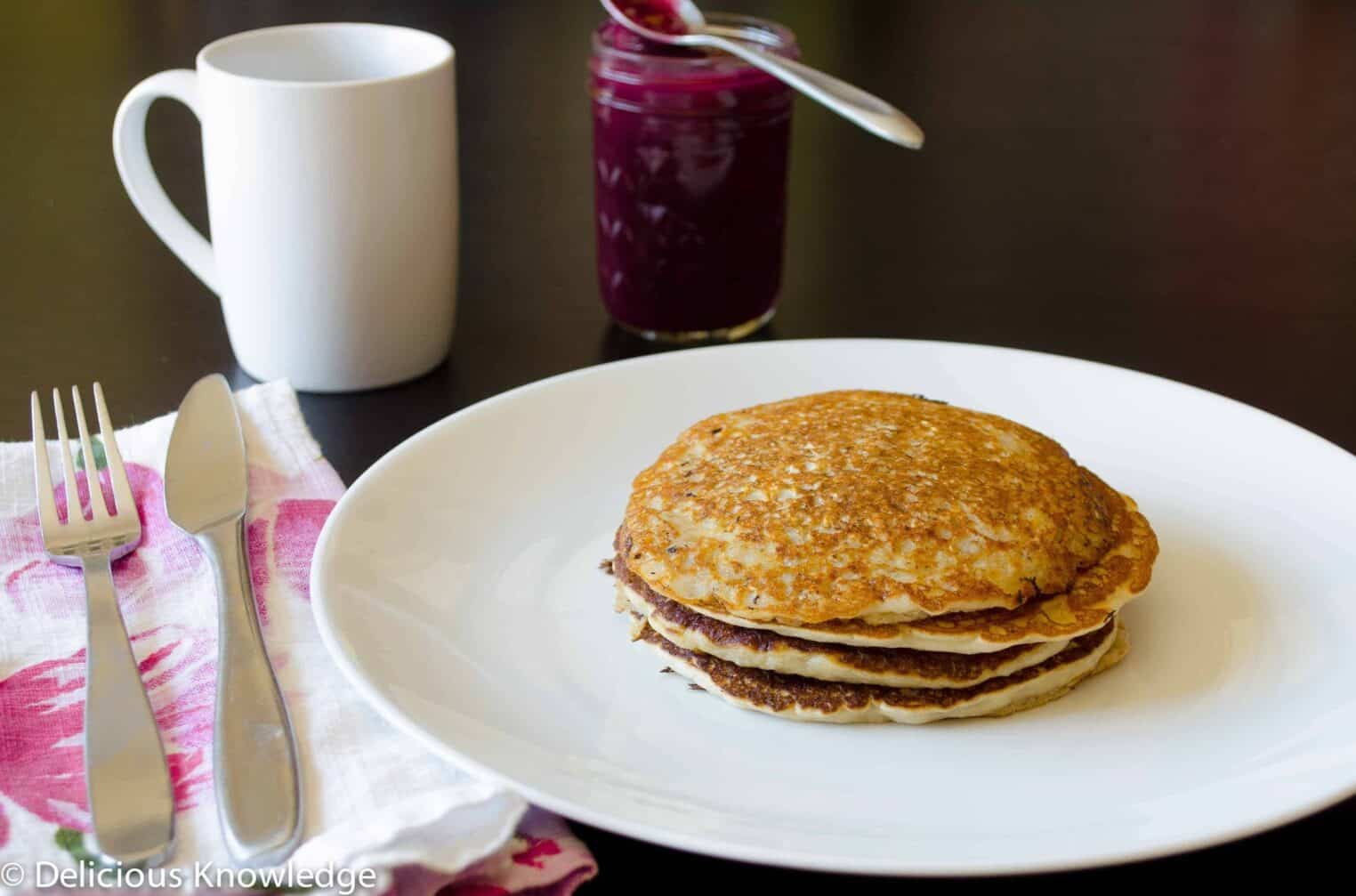 Oatmeal Pancakes with fresh blueberry glaze! Healthy, vegan, and perfect for a lazy brunch or weekday breakfast.