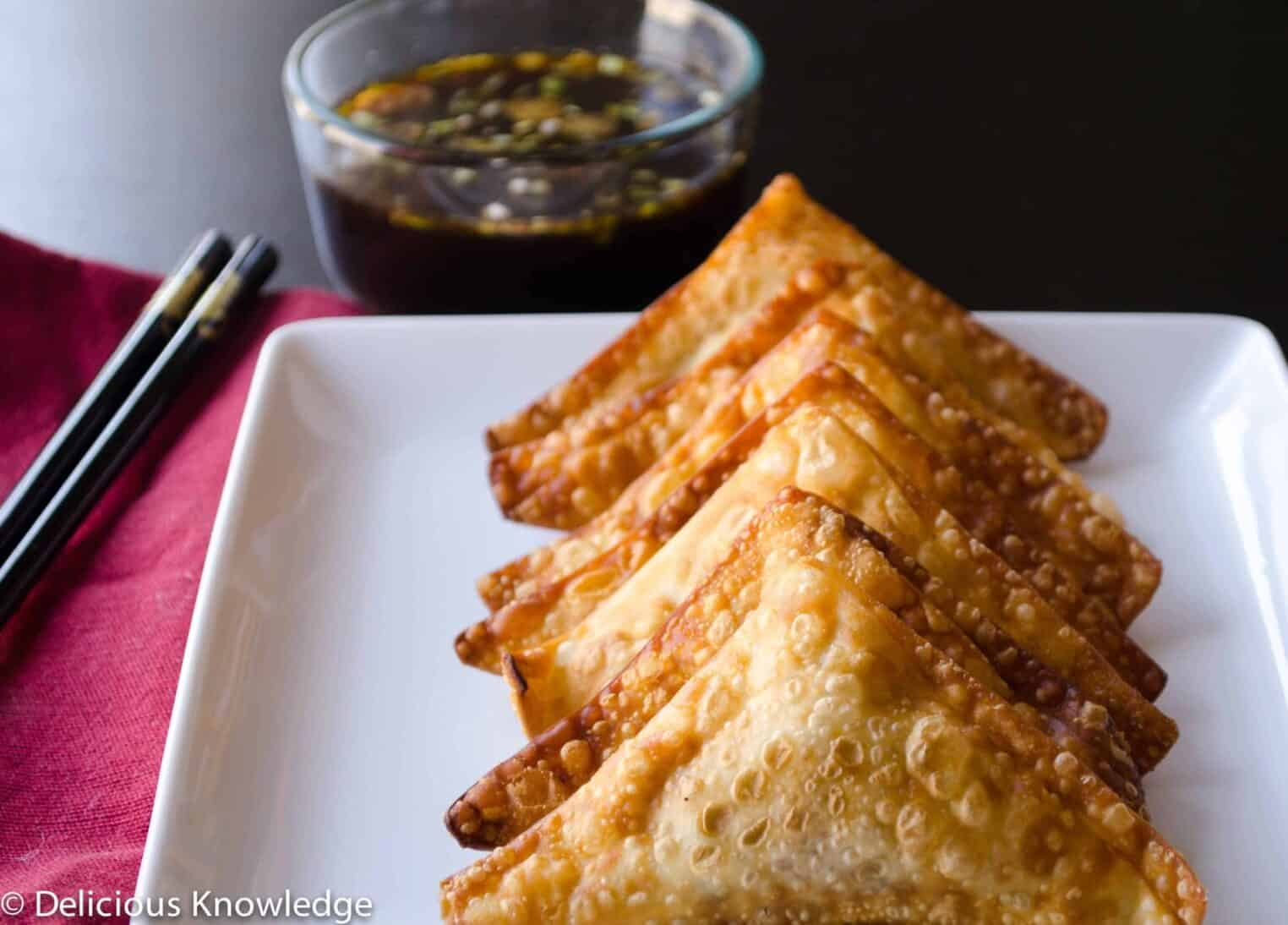 Avocado Wontons! Like crab napoleons, but vegan and healthy! Wonton skins stuffed with avocado, corn and veggies. Lightly fried and served with a dipping sauce.