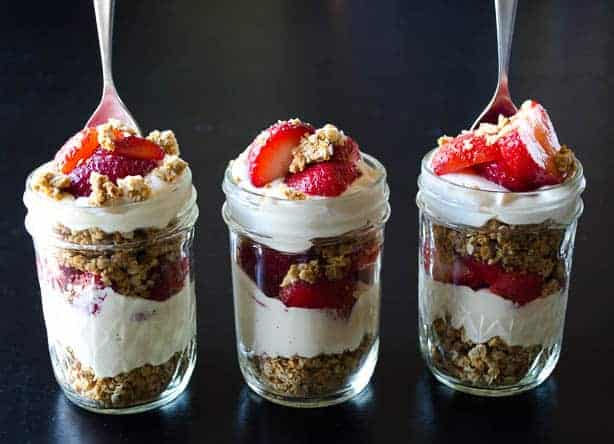 Vegan Strawberry Cheesecake Parfaits! Cheesecake filling layered with nut clusters and fresh berries.