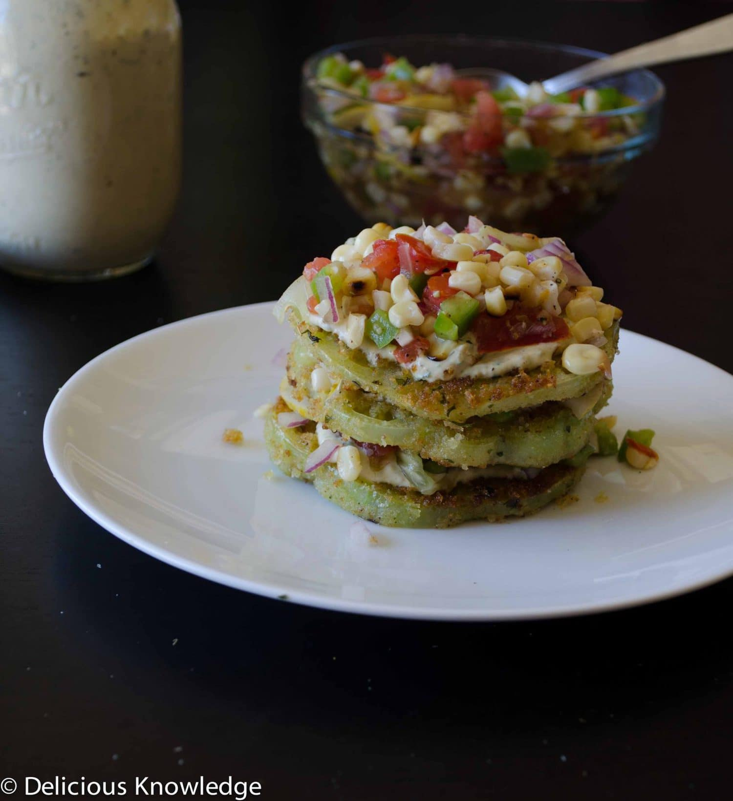 Fried Green Tomato Stacks with fresh corn relish and creamy remoulade sauce. Vegan