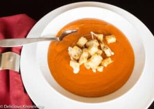 Creamy tomato bisque made with sundried tomatoes. Topped with homemade croutons and vegan cream.
