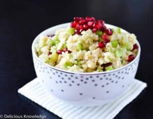 Pomegranate Quinoa Salad! A beautiful side dish loaded with nutrient rich pomegranate seeds, quinoa, and celery.