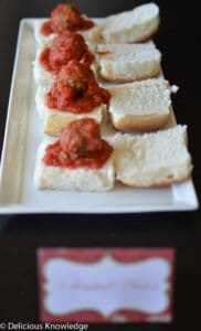 Perfect appetizer for the upcoming holiday season! Homemade vegan meatballs baked in tomato sauce. Served on slider buns.