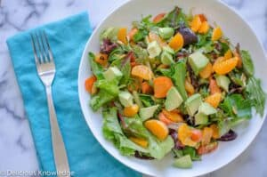 The best salad! Greens tossed with roasted carrots, mandarin oranges, avocados and pumpkin seeds. Vegan & Gluten-Free