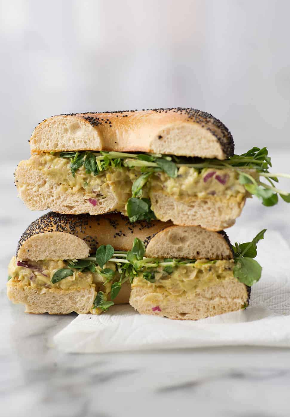 vegan bagel sandwich with avocado and chickpeas