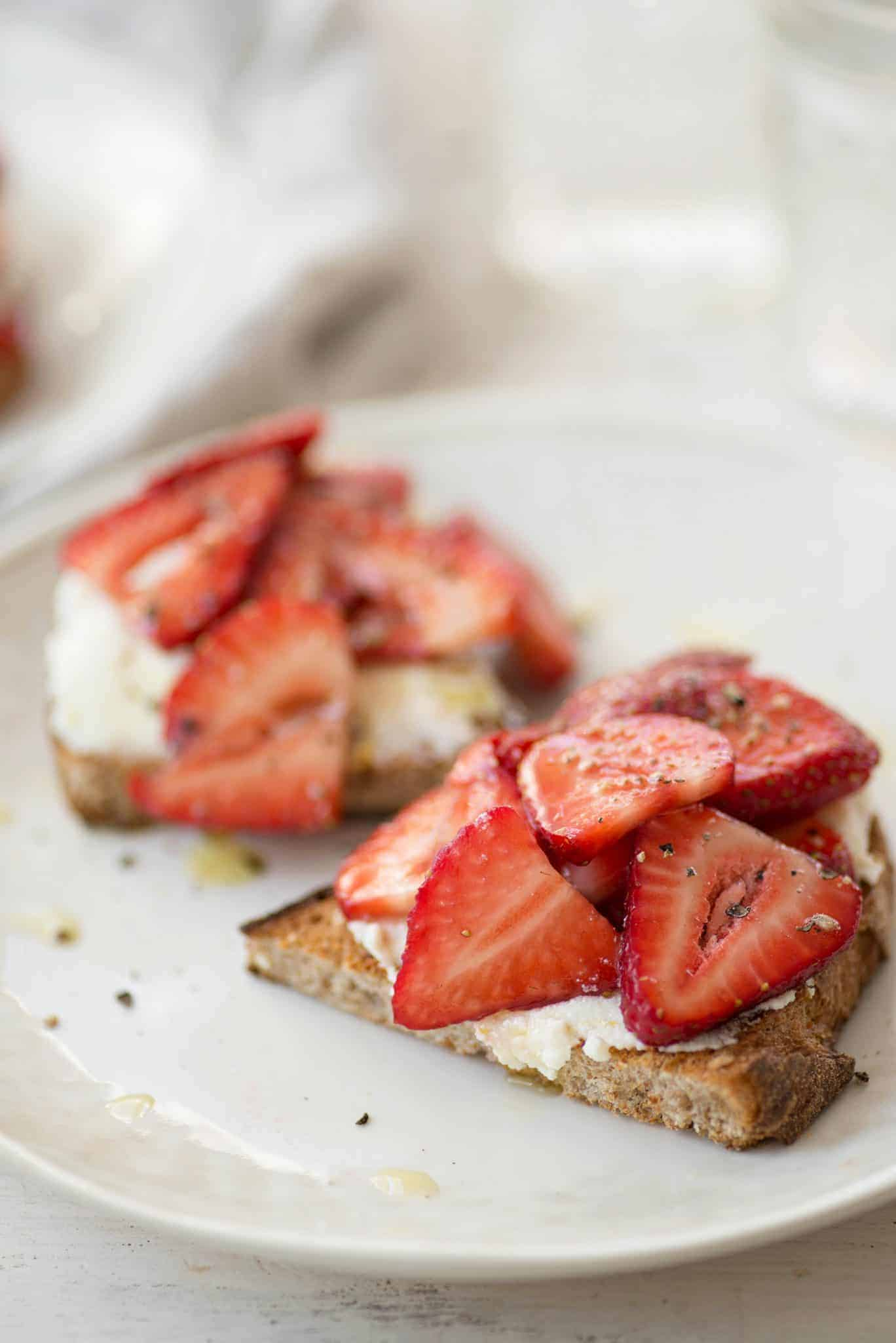 Balsamic Strawberry Ricotta Toast. The perfect breakfast for this time of year. Balsamic soaked berries spooned onto thick toast with orange ricotta. | delishknowledge.com