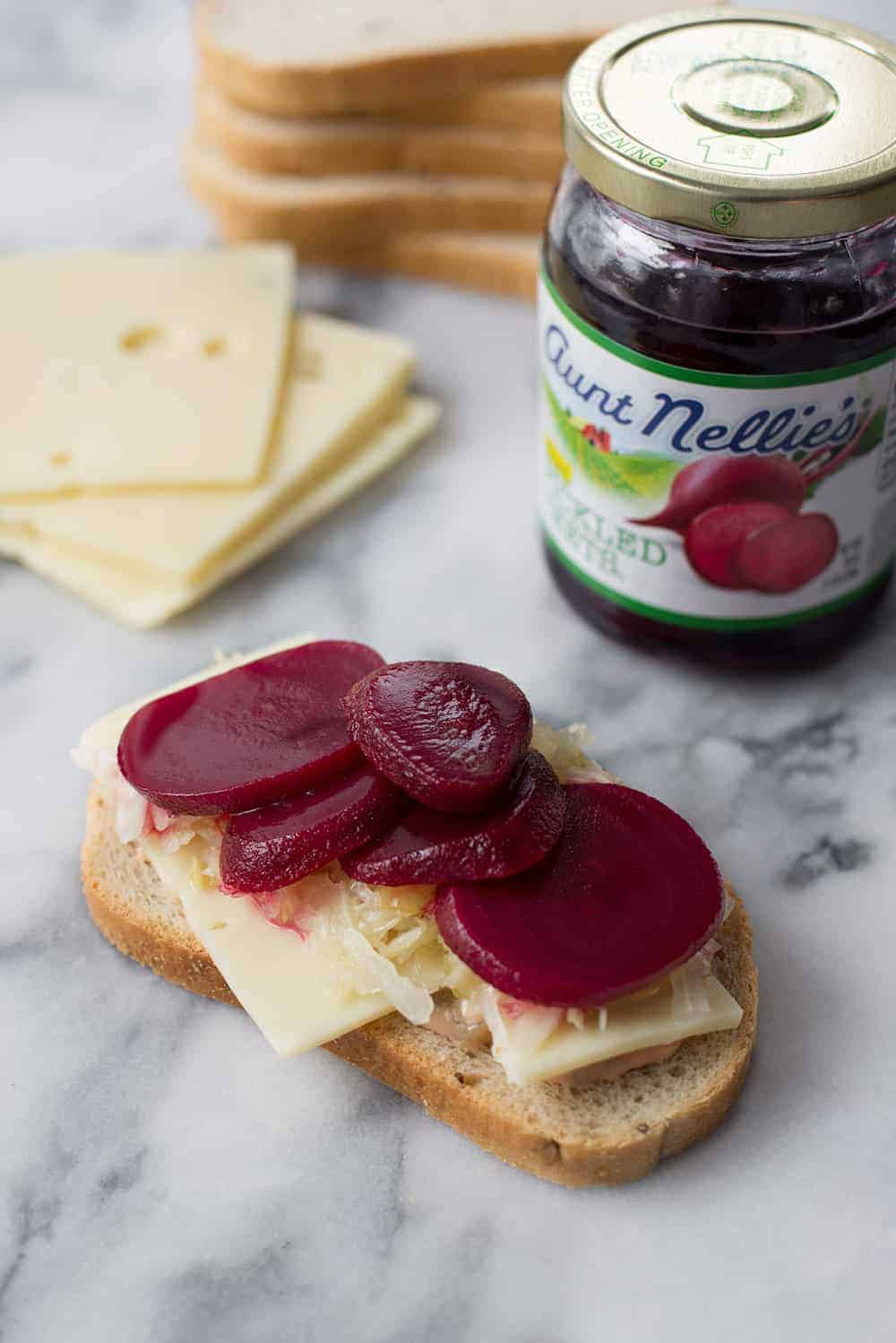 rye bread with sauerkraut, swiss cheese and pickled beets