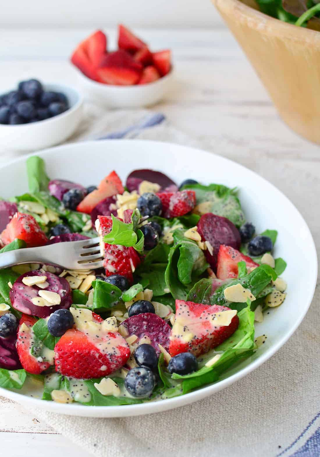Beet and Berry Salad with dairy-free poppy seed dressing! This salad is packed with nutrients and perfect for lunch or dinner! | www.delishknowledge.com