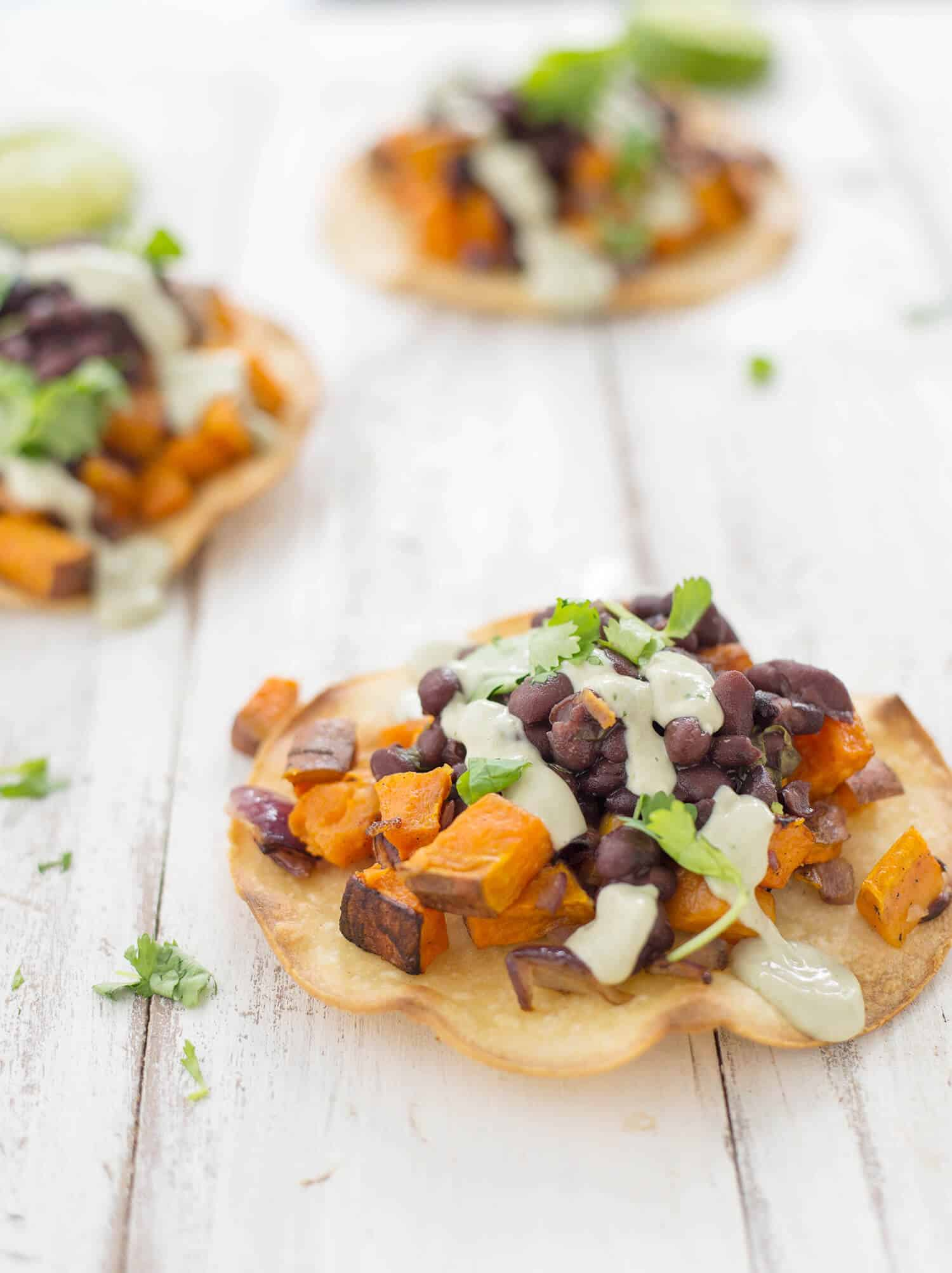 Black Bean and Sweet Potato Tostadas! Seasoned black beans piled high ...