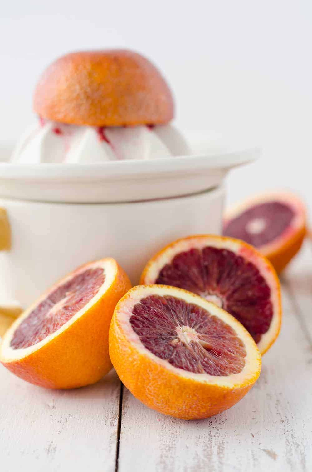Blood Orange Chia Pudding Parfaits! Make ahead breakfasts! Layers of blood orange chia jelly with vanilla yogurt. Make them before for an easy grab and go breakfast option!   www.delishknowledge.com