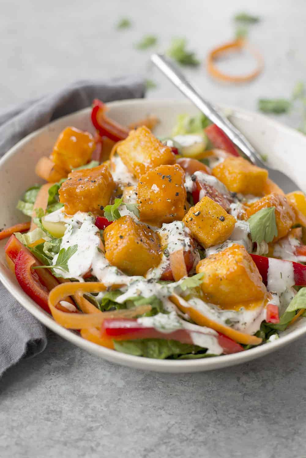 salad with buffalo tofu and vegan ranch