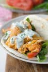 Buffalo Cauliflower Flatbreads! These vegan sandwiches are packed with so much flavor! Roasted buffalo cauliflower on homemade flatbreads. Topped with a simple dairy-free ranch dressing. | www.delishknowledge.com