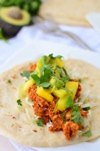 Chipotle Tempeh Tacos! Sauteed tempeh with a spicy chipotle sauce. Topped with a quick mango-pineapple-avocado salad. Vegan & Gluten-Free option.