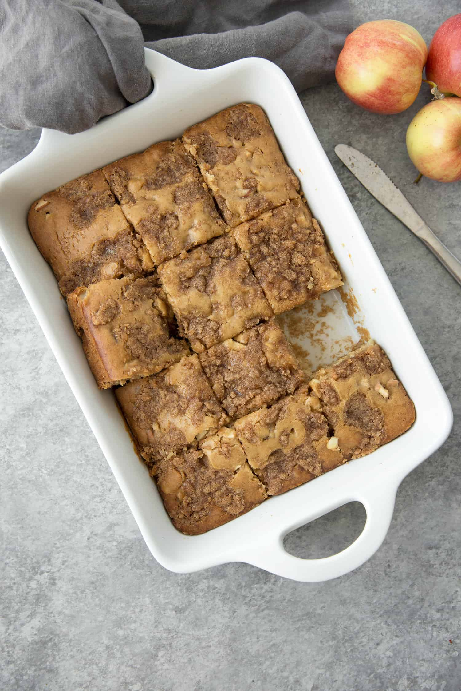 Cinnamon Spice Apple Cake! Similar to a coffee cake, perfect for brunch. This cake is packed with fresh apples and spices and topped with cinnamon-sugar. A must-make for Fall. | www.delishknowledge.com