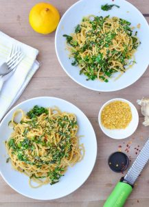 Collard Green Pasta! Shredded collards tossed with hot pasta, garlic, olive oil, red pepper flakes and seasoned bread crumbs. Dinner is ready in just 20 minutes! Vegan | www.delishknowledge.com