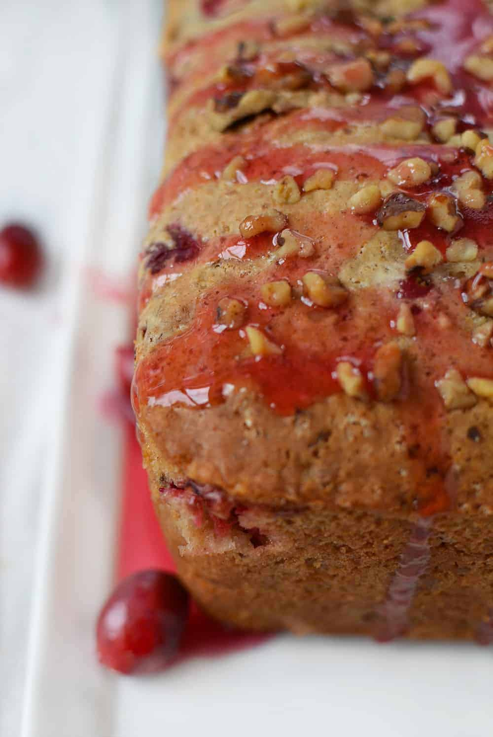 Vegan Cranberry Orange Ginger Bread! This skinny bread is loaded with flavors of fall, and easily made vegan! Serve as is or with a luscious cranberry drizzle. | www.delishknowledge.com