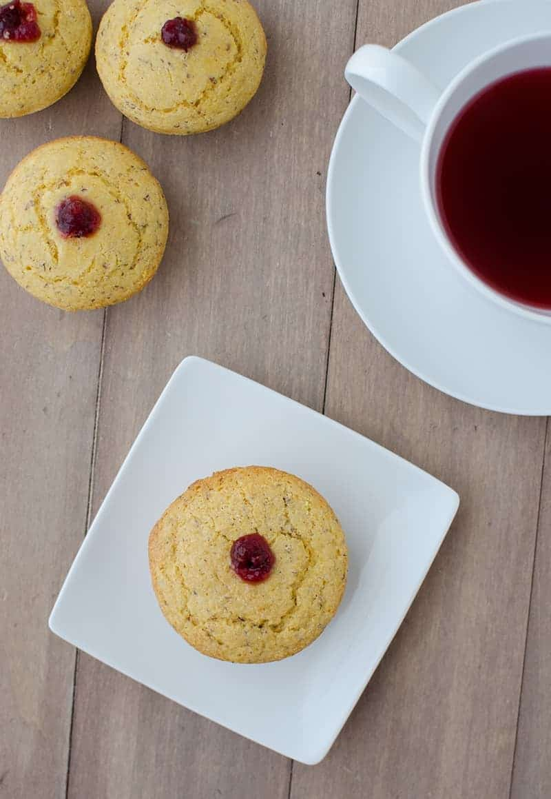 Cranberry Corn Muffins! Two Thanksgiving favorites in one! Vegan corn muffins stuffed with cranberry jam. | www.delishknowledge.com