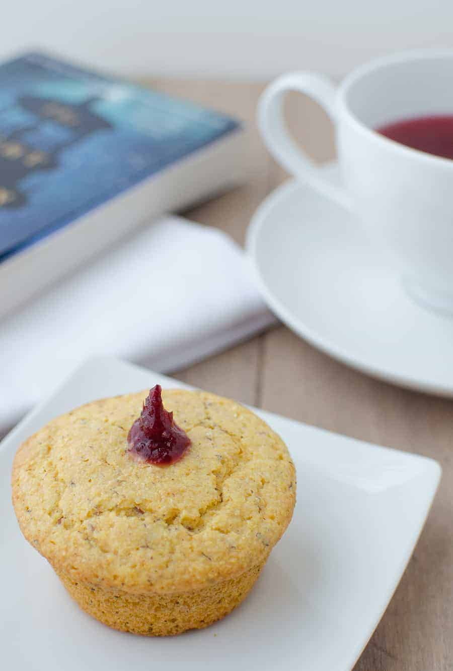 Get your bread baskets ready! These jam filled corn muffins are the perfect sweet & savory side to enjoy on it's own or with a full plate of Thanksgiving favorites. Vegan corn muffins stuffed with cranberry jam. | www.delishknowledge.com