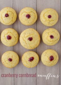 Cranberry Corn Muffins! Two Thanksgiving muffins in one! Vegan corn muffins stuffed with cranberry jam. | www.delishknowledge.com