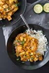 Vegan Delicata Squash Red Curry! If you're looking for a healthy, plant-based dinner- this is it! Simmered tofu and squash in a mild red curry sauce. Easily gluten-free. | www.delishknowledge.com