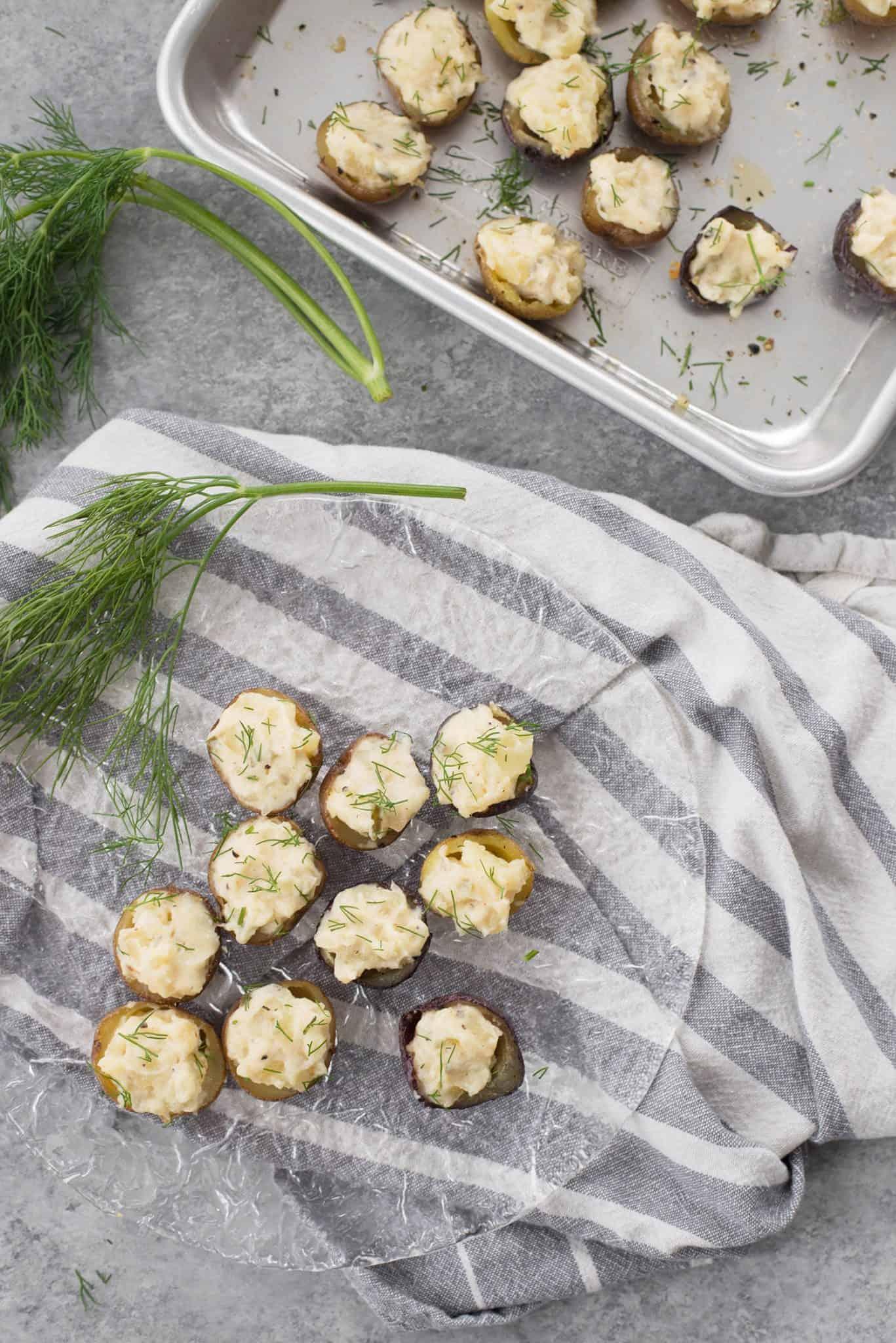 Deviled Potatoes! These mini potatoes are the perfect Spring appetizer. Crispy potato shells stuffed with deviled dill potato filling. Vegan and Gluten-Free. | www.delishknowledge.com