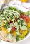 Falafel Salad with Tahini Parsley dressing! Crispy vegan falafel patties on top of salad with tahini parsley dressing. | www.delishknowledge.com