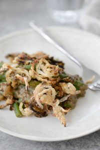 Vegan Fresh Green Bean Casserole! This is the PERFECT Thanksgiving side dish! Fresh green beans in a homemade mushroom sauce with faux-fried onions. | www.delishknowledge