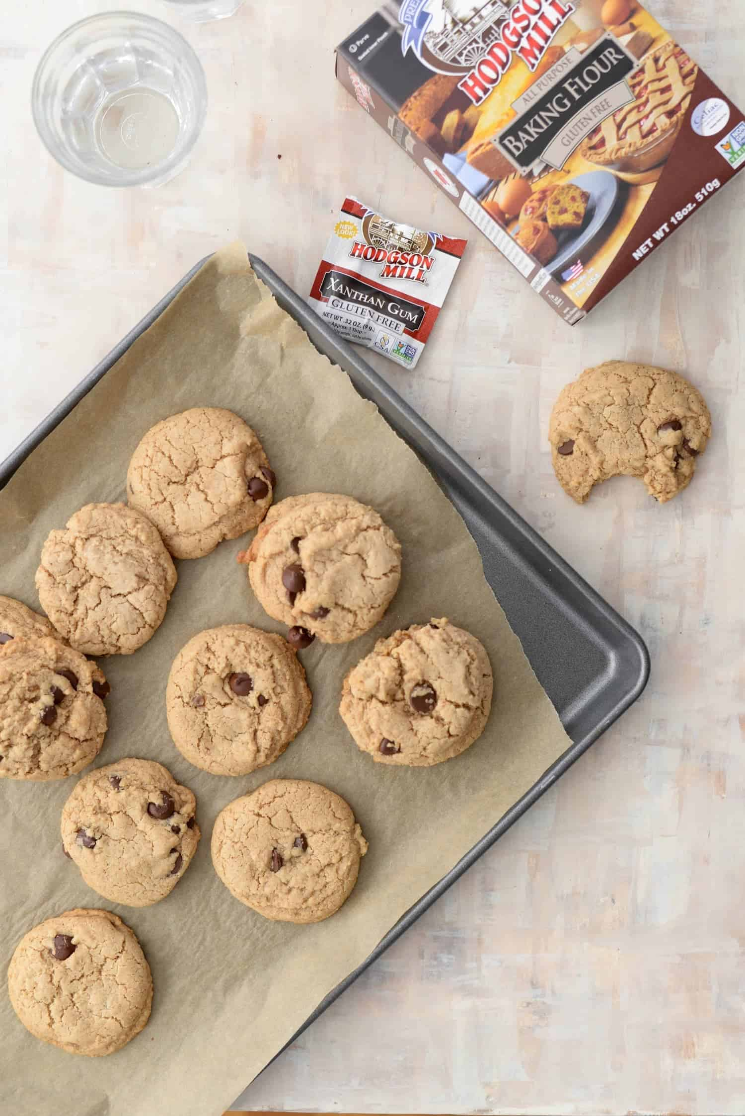 baking sheet with vegan and gluten-free chocolate chip cookies