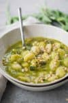 Gnocchi Pesto Soup! This creamy pesto soup is loaded with herbs, zucchini and pillowy gnocchi. Vegan | www.delishknowledge.com
