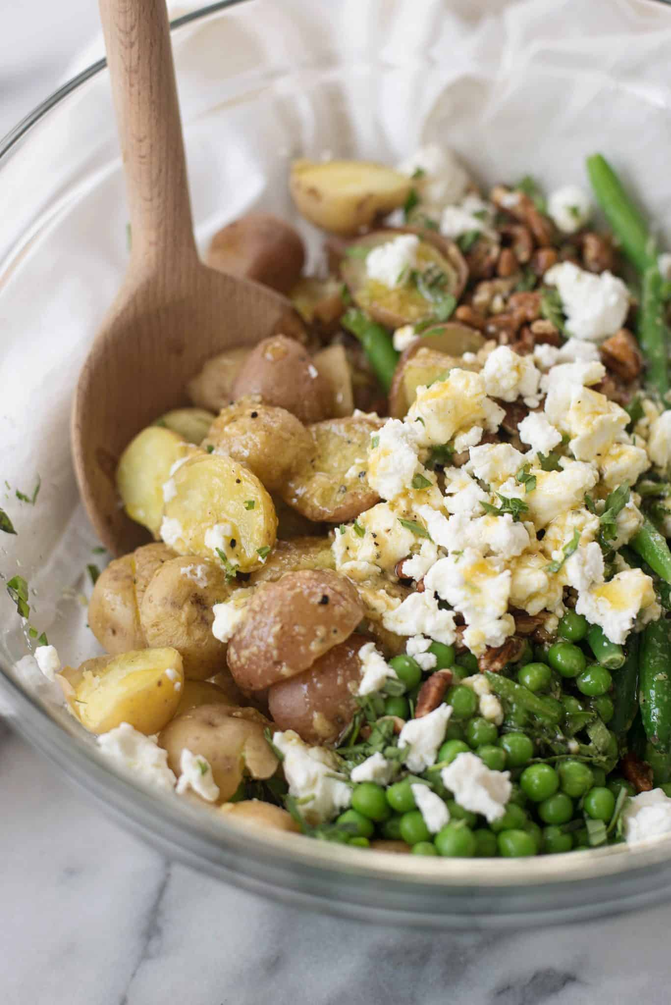 Green Bean, Potato and Tarragon Salad. This vegetarian potato salad is a must make for Spring or Summer. Tossed with peas, goat cheese, pecans and a yummy maple-dijon dressing. Gluten-Free. | delishknowledge.com