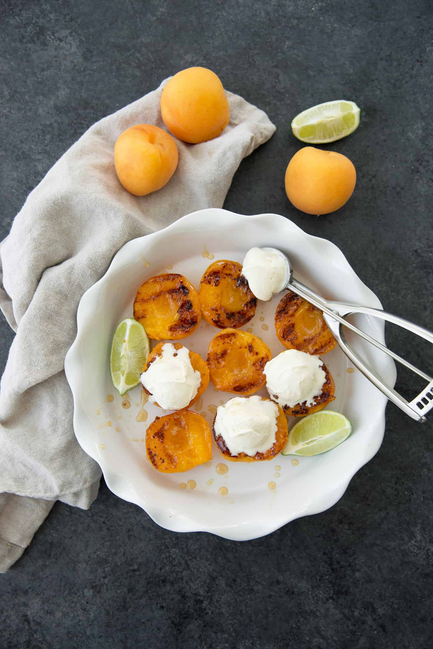 Grilled Honey Ginger Apricots with Ice Cream. This summer dessert is so easy, perfect for an easy entertaining dessert. Glutenfree and easily vegan. | www.delishknowledge.com