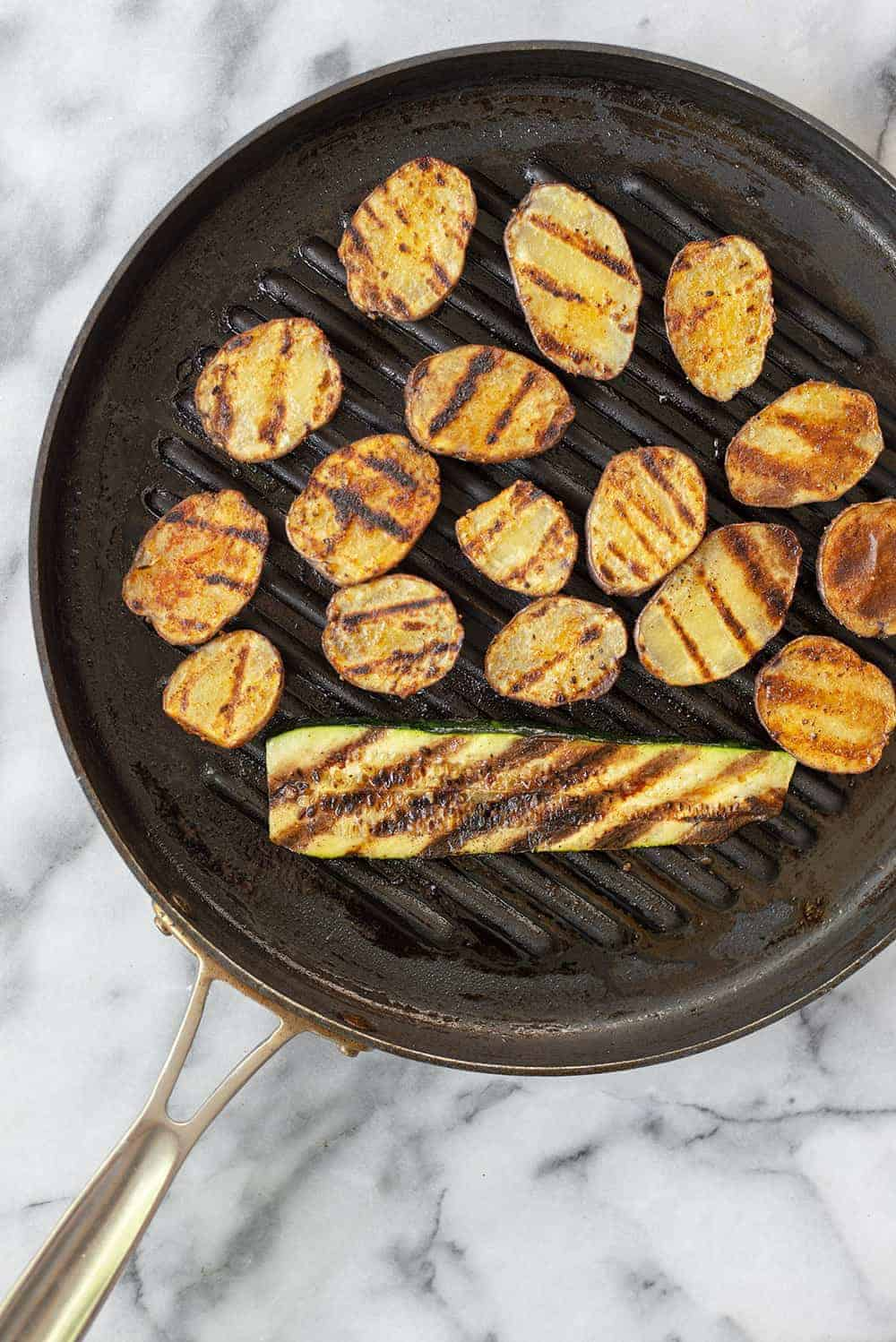 grill pan with potatoes and vegetables
