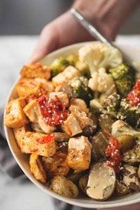 Harissa Tahini Tofu Buddha Bowls! Harissa roasted tofu, roasted potatoes, broccoli and cauliflower covered in a tahini harissa dressing. Grain-free, vegan and gluten-free. | www.delishknowledge.com