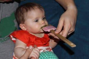 Caroline trying homemade baby food