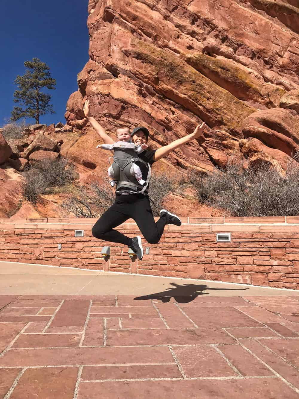 jumping in the ergo baby in the Red Rocks