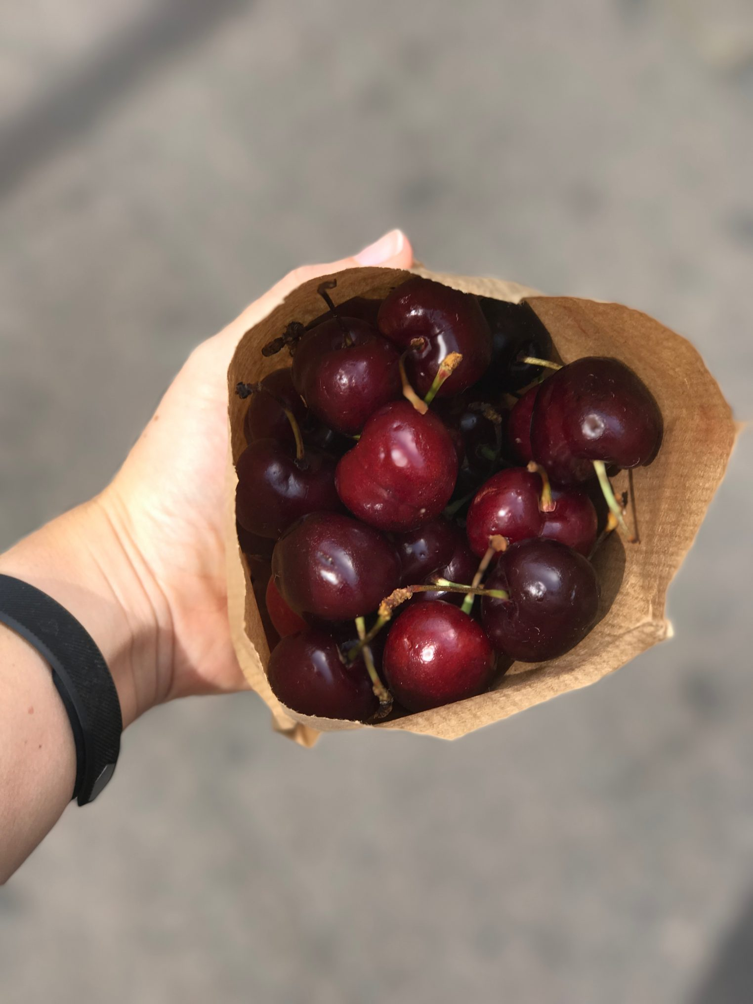 Fresh cherries from a market stall while strolling through the streets.