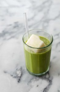 Iced Vanilla Matcha Latte! This creamy, dairy-free latte is perfect for hot summer days. Served over coconut milk ice cubes for a frosty treat PLUS a trick for blending matcha easily! Vegan & Gluten-Free | www.delishknowledge.com