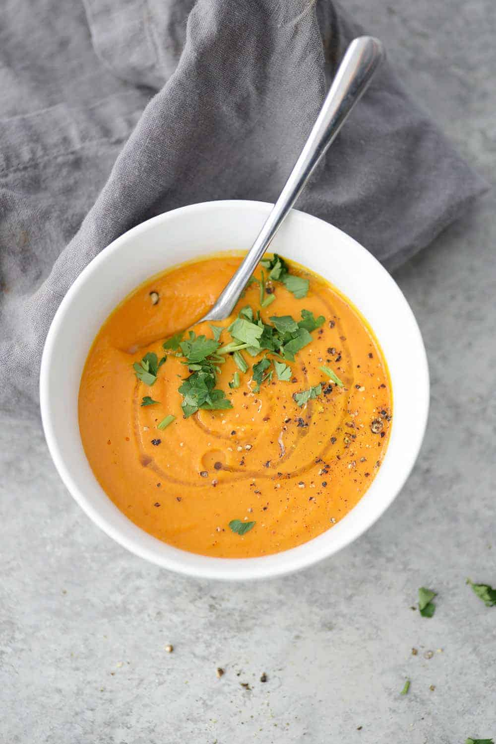 Single bowl of carrot ginger turmeric soup