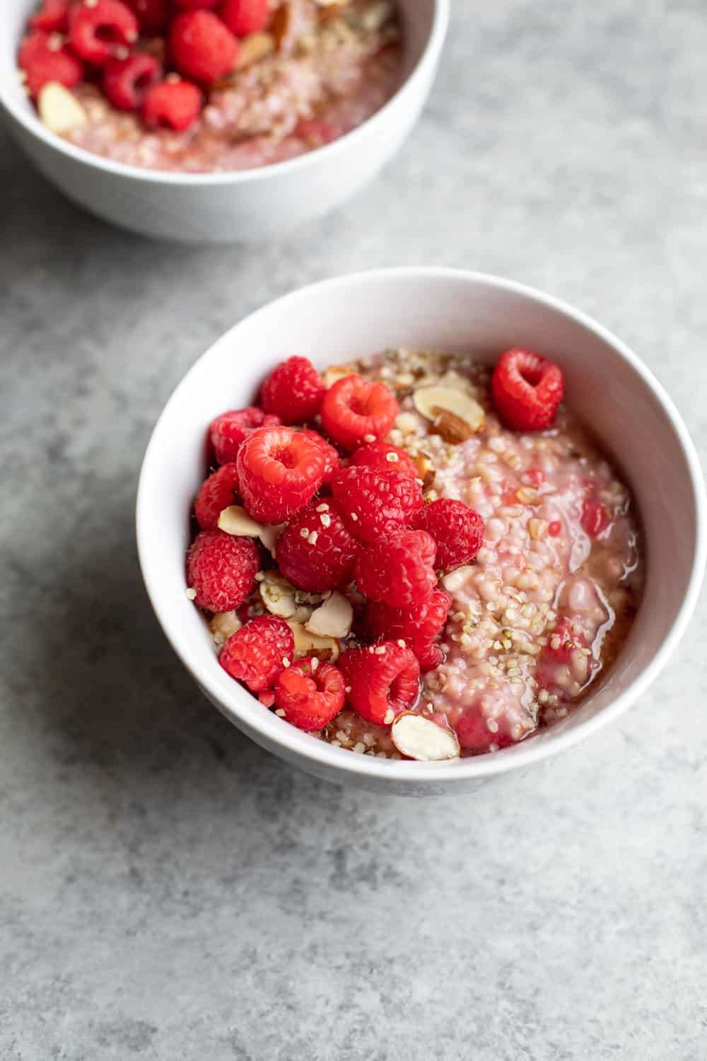 close up bowl of instant pot oats with raspberries