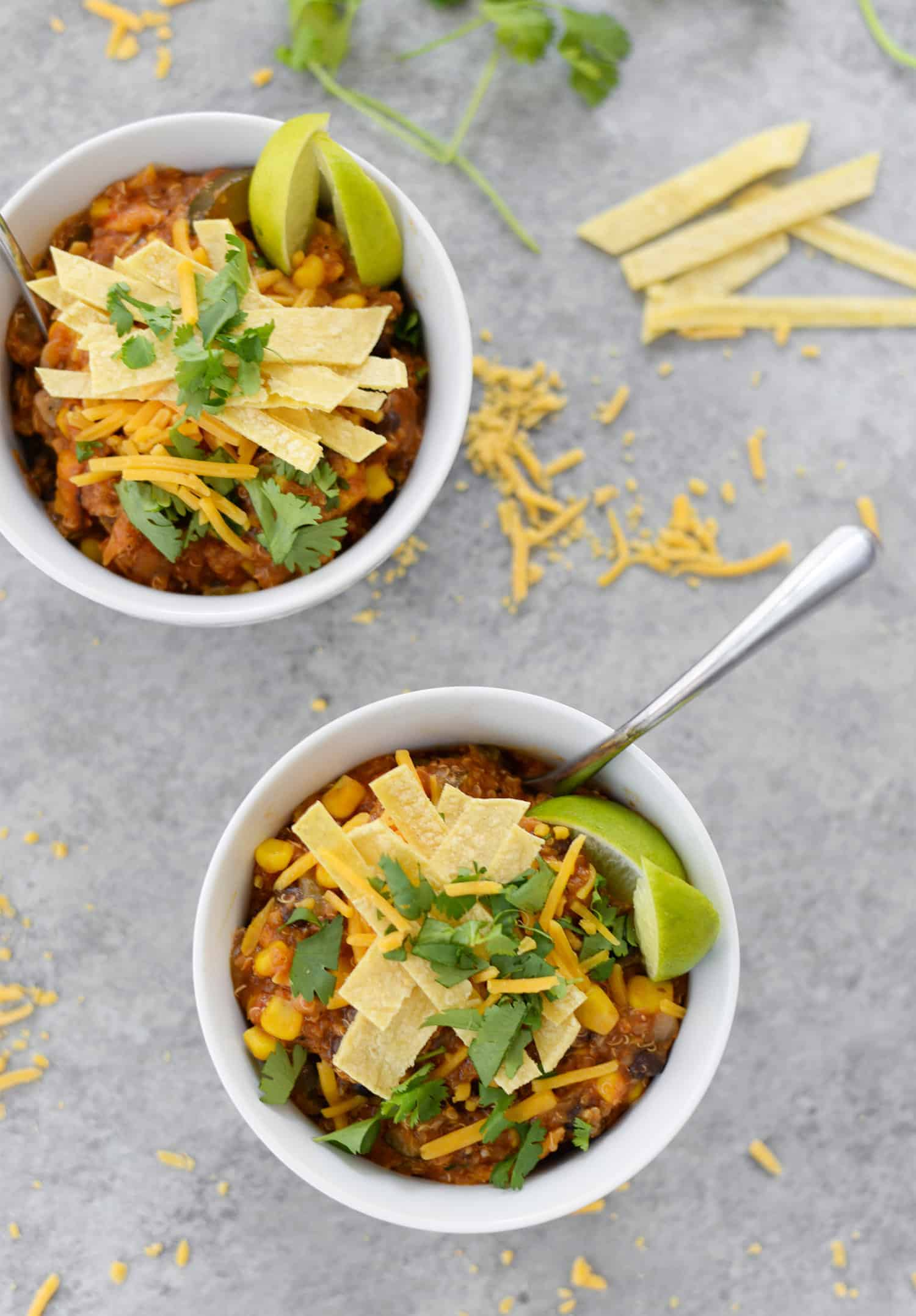 Instant Pot Enchilada Casserole. Yummy, vegetarian and gluten-free! Cooked quinoa, beans, corn and corn tortillas in a homemade enchilada sauce. Delicious! #mexican #dinner #recipe #healthy #glutenfree #vegetarian #quinoa #weeknight | www.delishknowledge.com