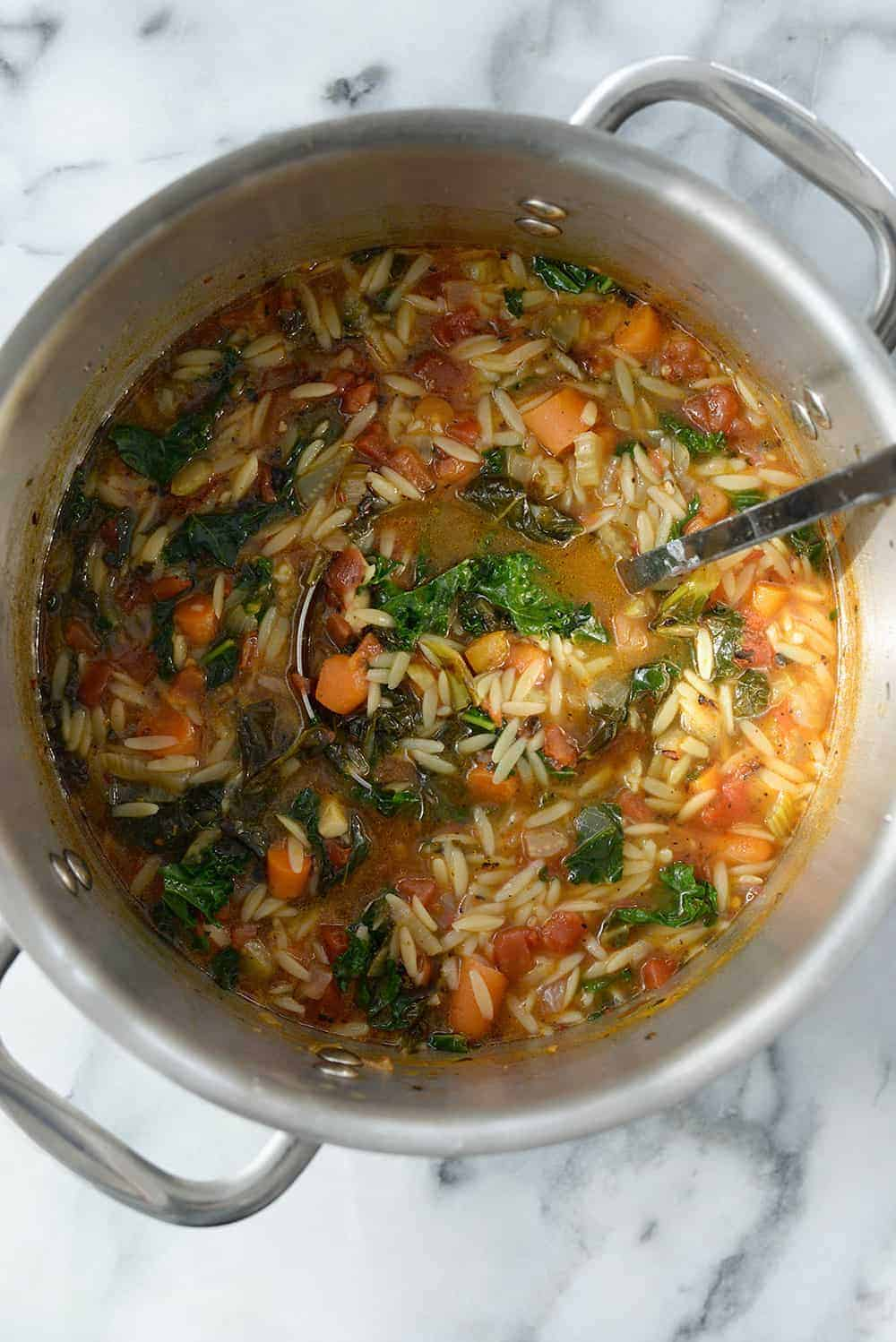 pot of vegan tuscan kale soup with orzo