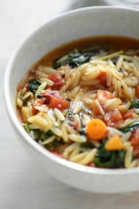 close up bowl of vegan kale and orzo soup