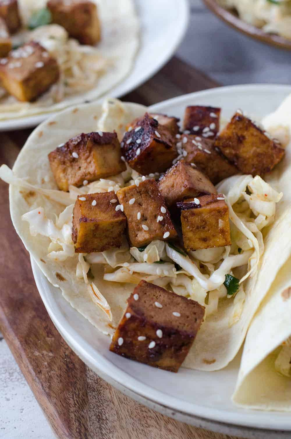 Korean Tofu Tacos! Crispy, Spicy tofu with a refreshing, cooling slaw. Must try this vegan dinner recipe! | www.delishknowledge.com