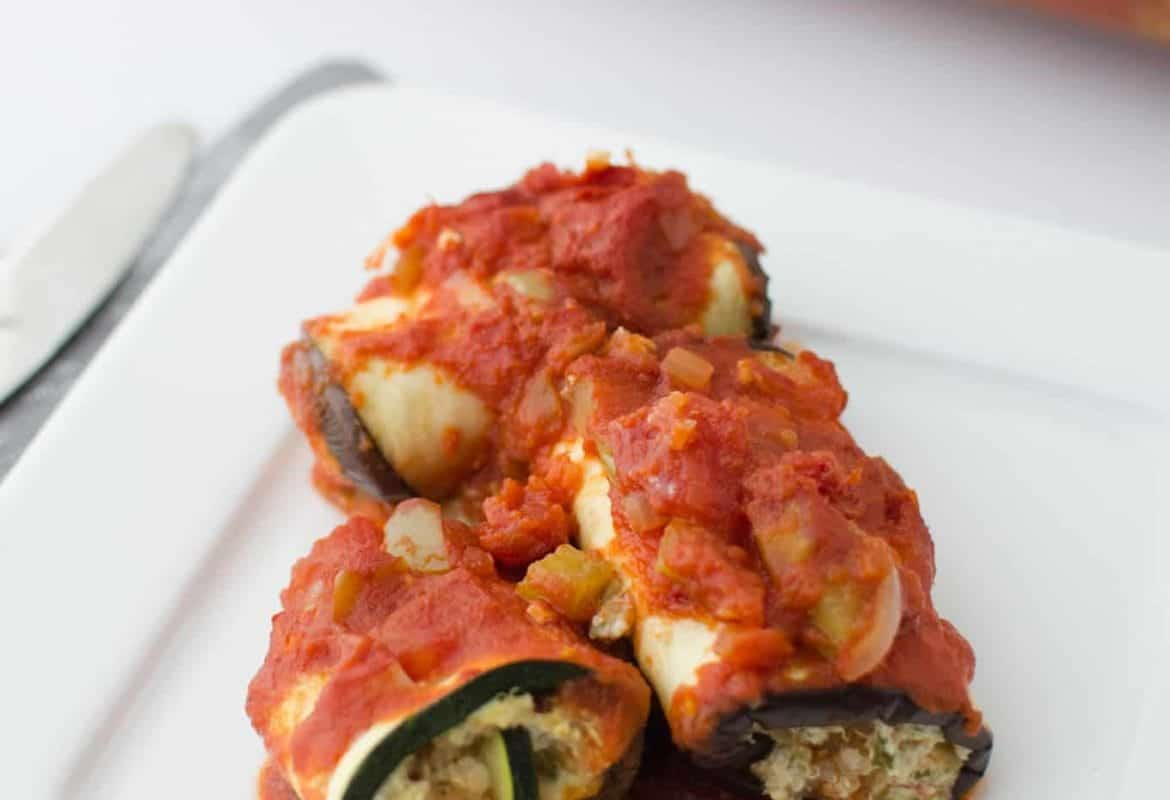 Finally! A healthy lasagna! Lasagna sans noodles! Slices of roasted zucchini and eggplant stuffed with herbed ricotta cheese & quinoa! Gluten-free and can be made either vegan or vegetarian!