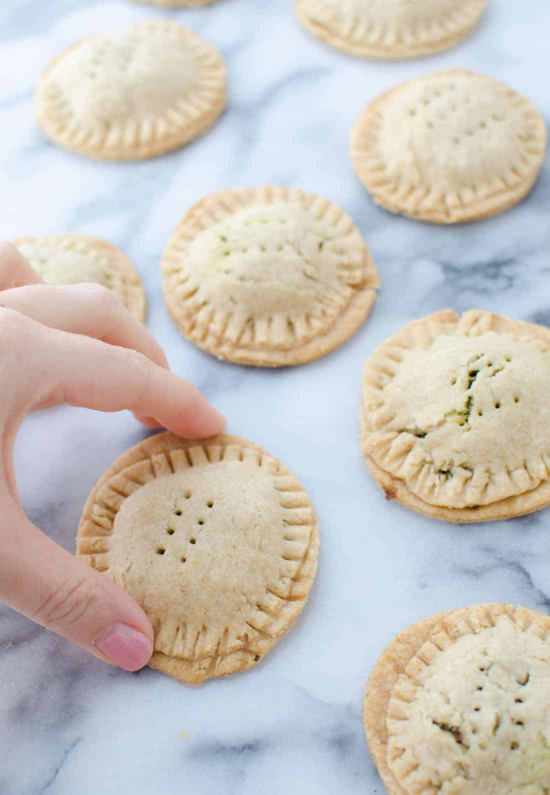 Lentil Hand Pies with Walnut Pesto! Lentil salad stuffed into homemade pie crust. Perfect for picnics, potlucks or lunches! #vegan | www.delishknowledge.com