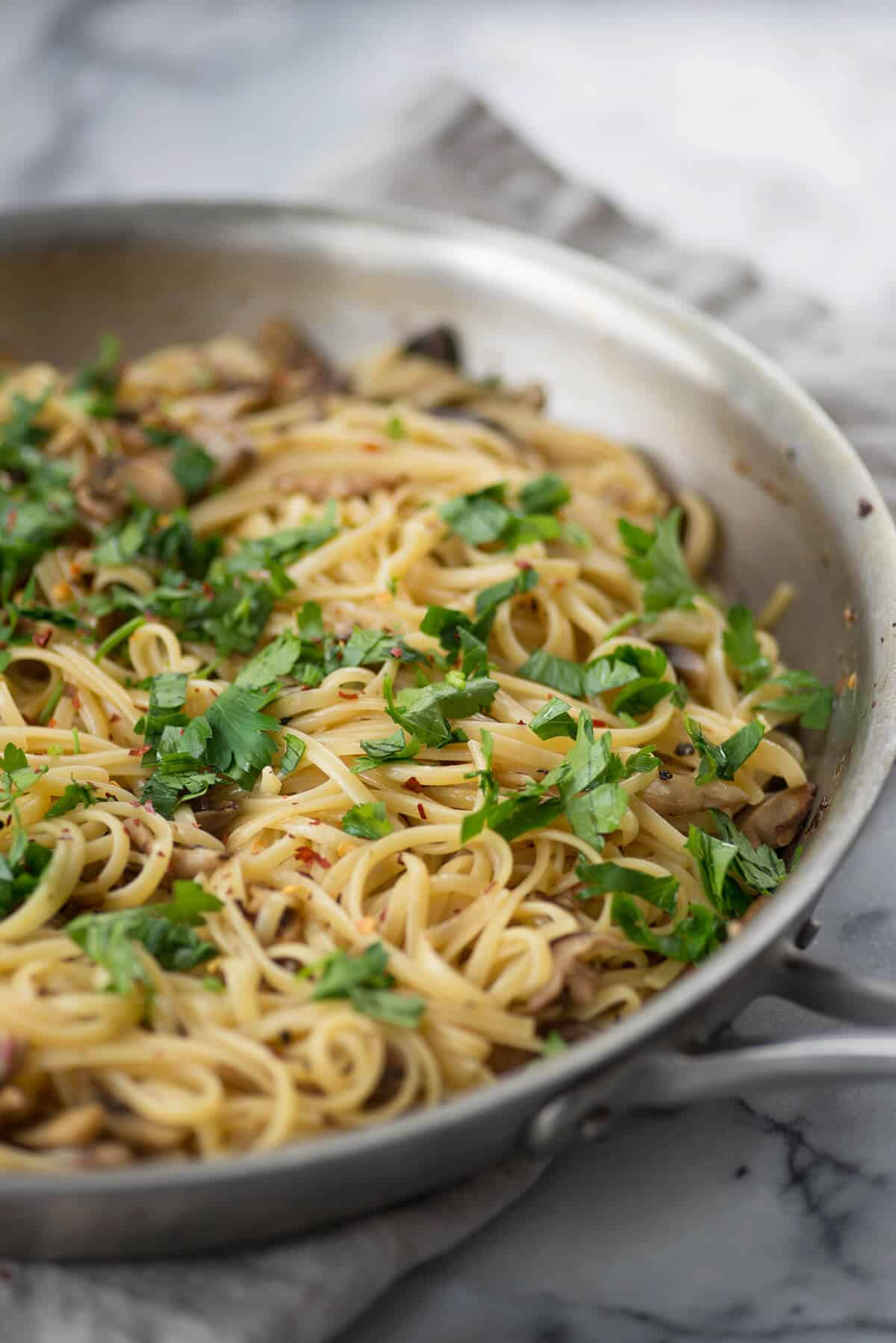 Linguine in Shiitake Wine Sauce! You can't believe this pasta is vegan, super creamy with a trick to making glossy, delicious pasta. | www.delishknowledge.com