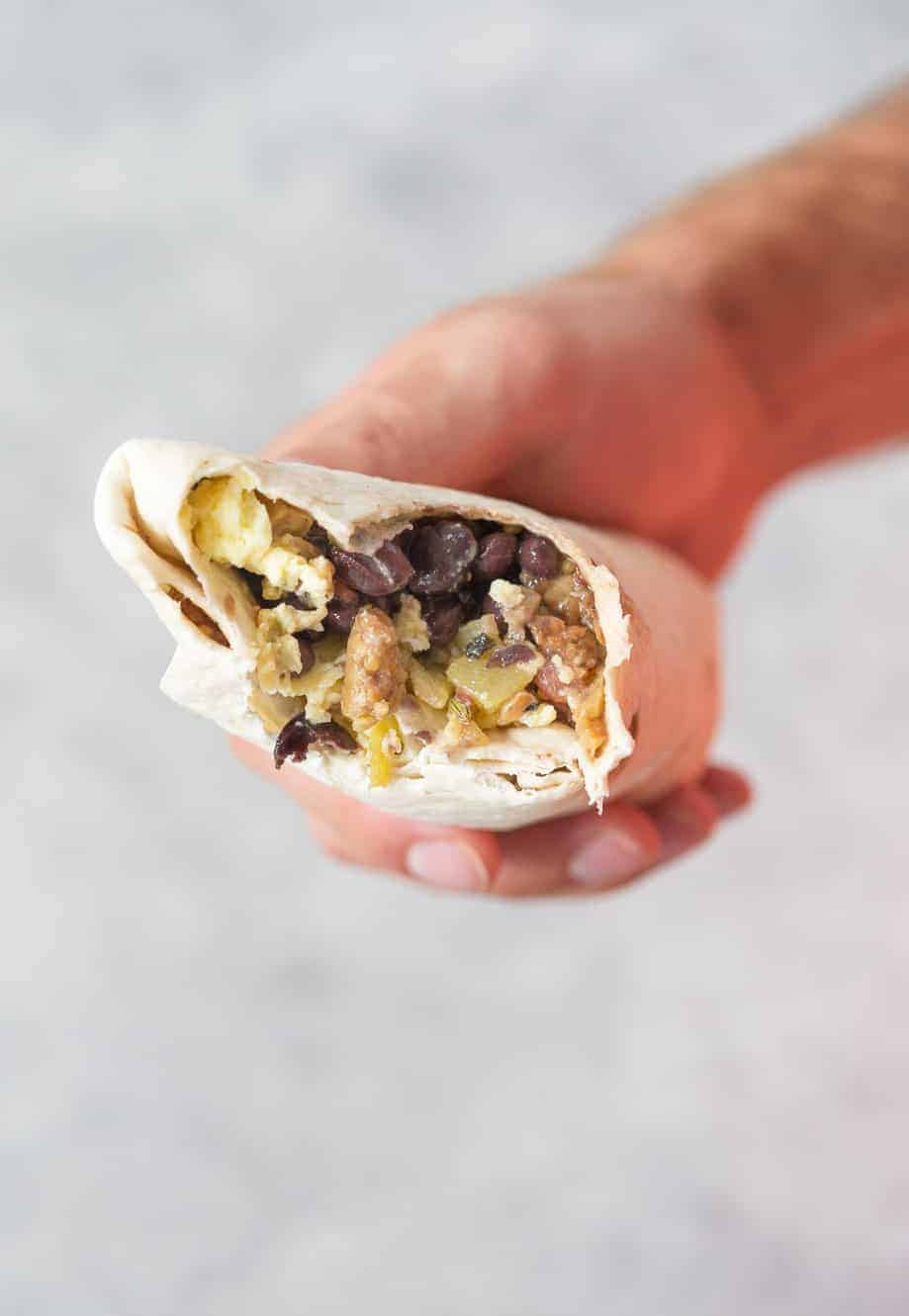breakfast burrito with bite out of it