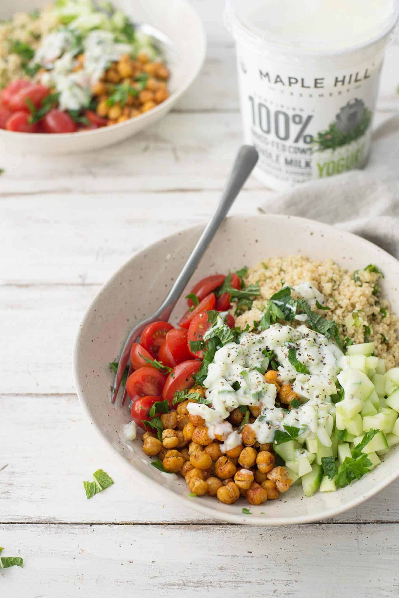 Mediterranean Yogurt Bowl, just like a falafal sandwich! Crispy chickpeas, tomatoes, mint, parsley, couscous, pickled onion and a tangy yogurt sauce. | delishknowledge.com